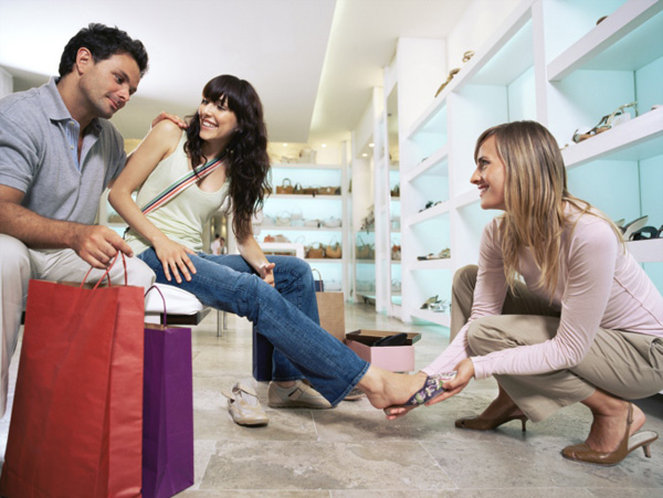 Woman at shoe store with boyfriend