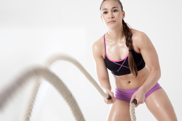 Woman with battle ropes