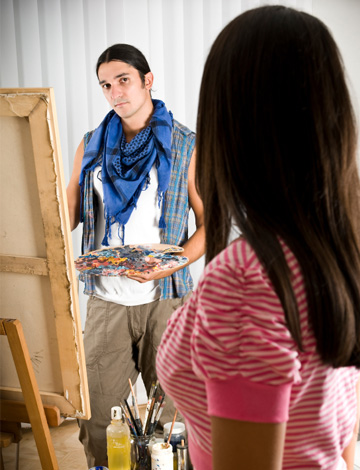 Woman being painted by her artist boyfriend