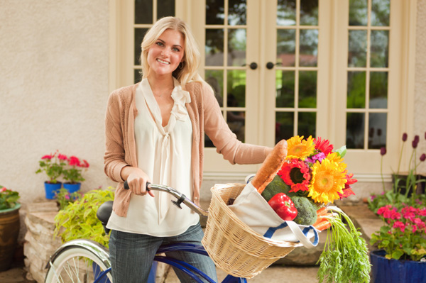 Woman with bike returning from farmer's market