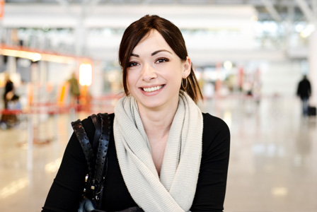 Woman with bright skin at airport