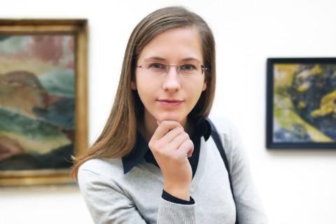 woman browsing art