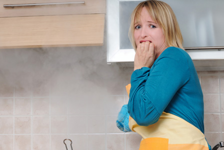 Woman burning oven