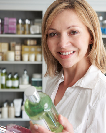 Woman buying skin care products abroad