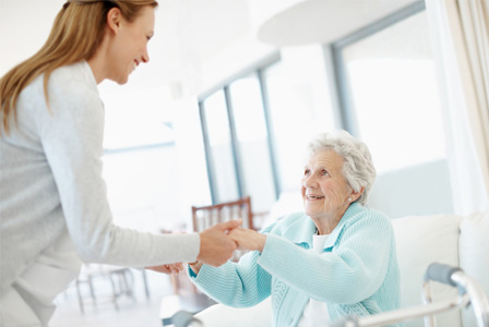 Woman caring for elderly mother