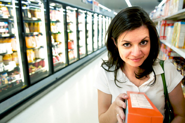Woman checking label for gluten