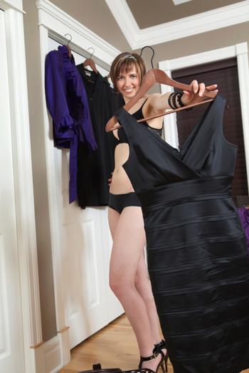 Woman choosing black dress