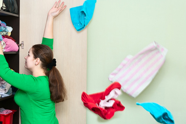 Woman cleaning out closet