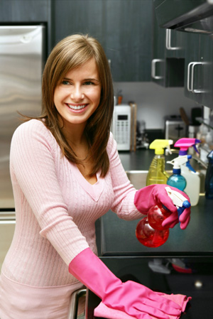Woman cleaning kitchen grease