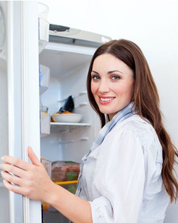 woman with a clean refrigerator