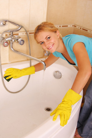 Woman cleaning tub