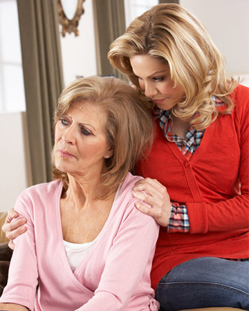 woman consoling senior mother