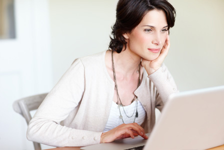 Woman contemplating purchase online