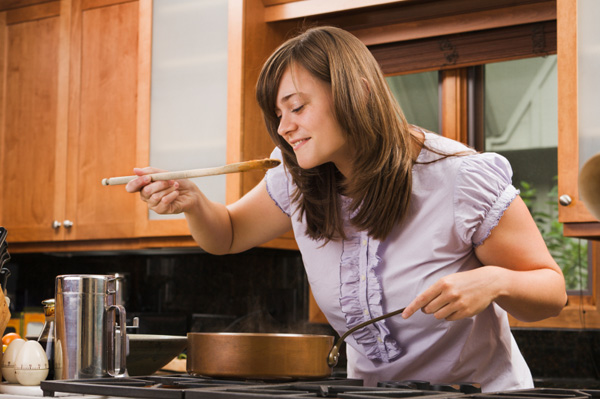 Woman cooking with skillet
