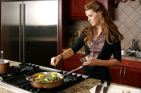 Woman cooking in a clean kitchen