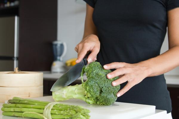 Woman cutting broccoli