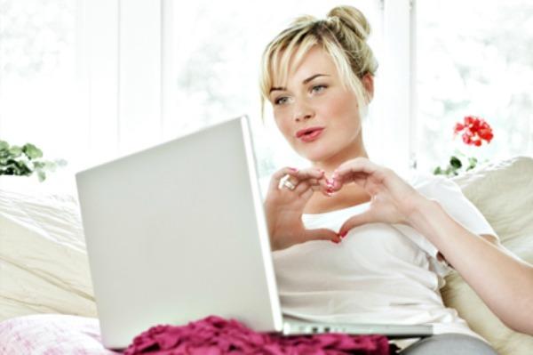 Woman talking to long distance boyfriend on Skype