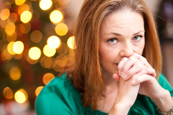 Woman depressed at holiday table