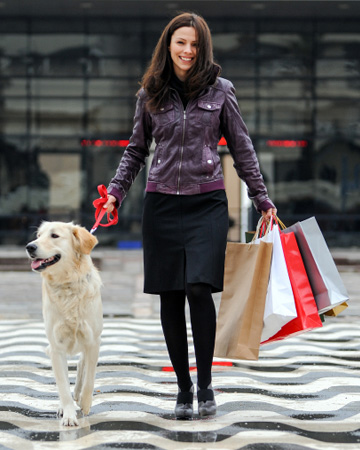 Woman walking with dog and shopping
