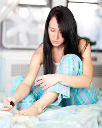 woman doing home pedicure