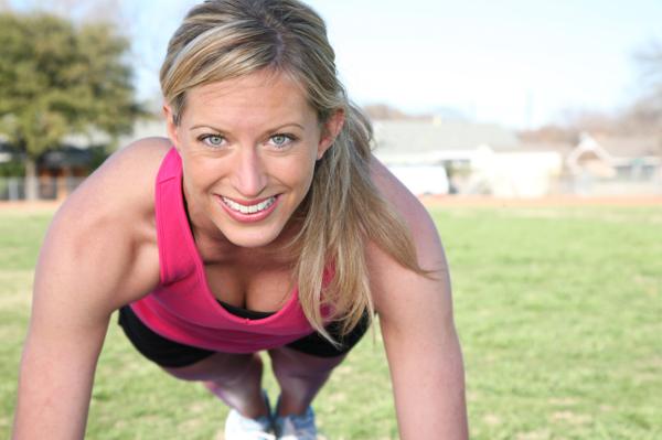 woman wearing pink tank top doing push ups