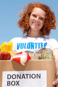 Woman donating box of food