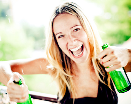 Woman double fisting beer