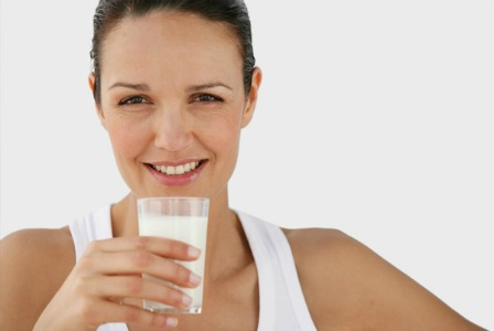 woman drinking milk for dental health