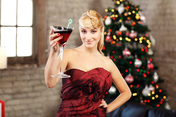 Woman drinking holiday cocktail