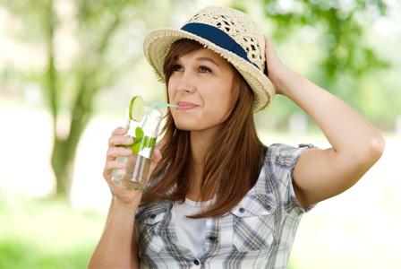 Woman drinking a mojito