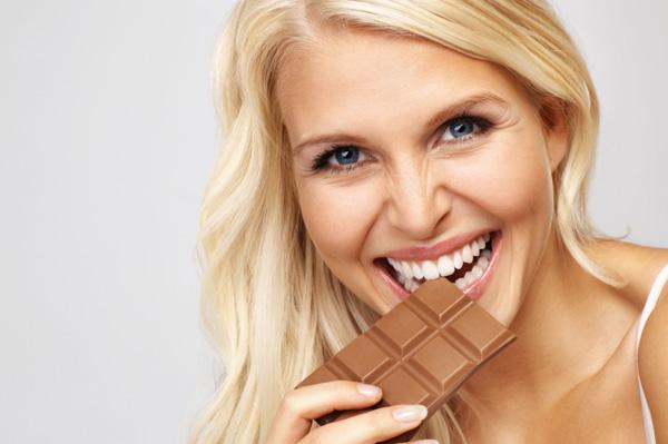 Woman eating chocoalte bar