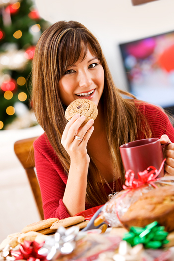 Woman eating Christmas Cookies at Swap