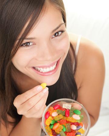 Woman eating gummy bears