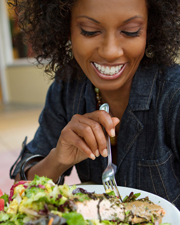 woman eating seafood salad