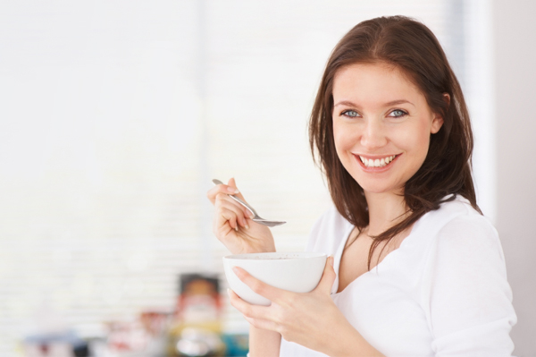Woman eating old fashioned oatmeal