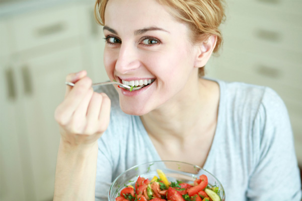Woman eating vegetarian meal
