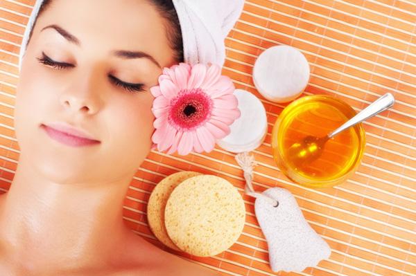 Woman enjoying spa day with honey