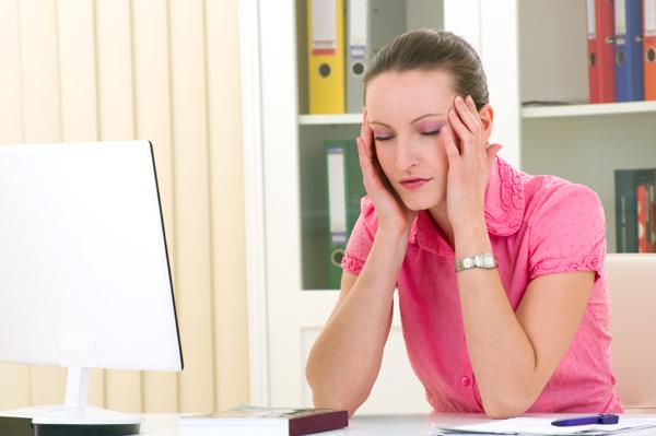 Woman falling asleep at desk