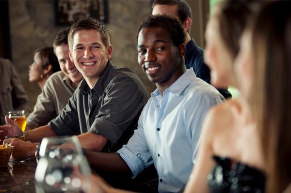 Woman at a bar flirting with men