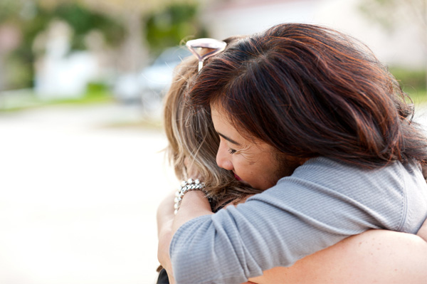 Woman forgiving friend