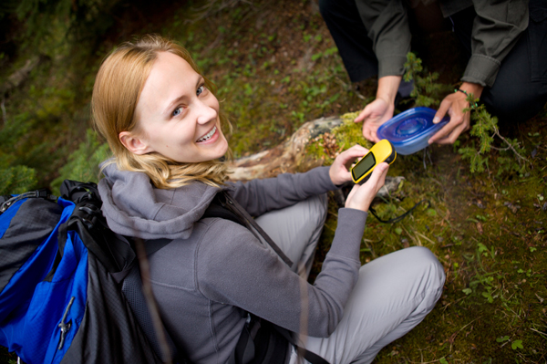 Woman on geoache hunt