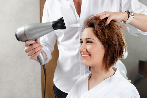 Woman getting easy to maintain haircut
