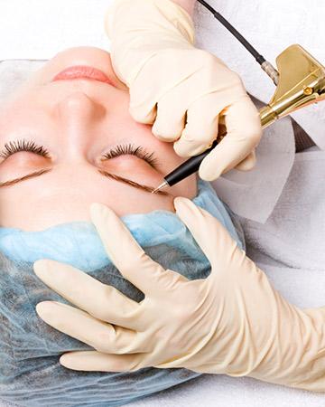 woman getting eyebrow tattoo