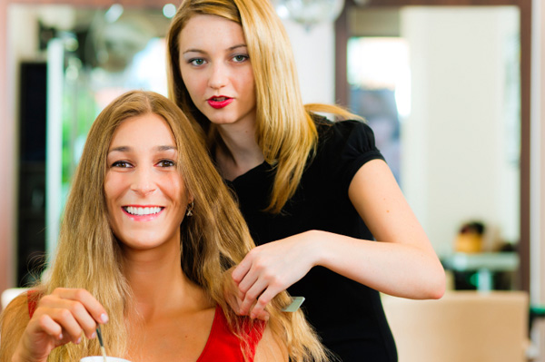 Woman at salon with fresh, updated hairstyle