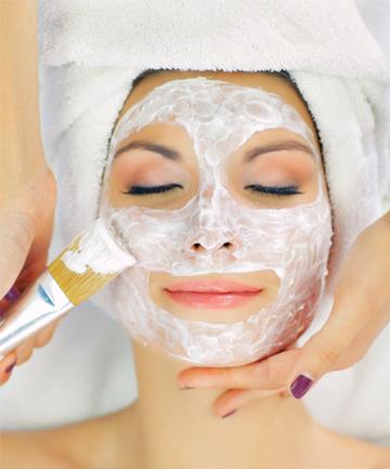 Woman having facial at spa