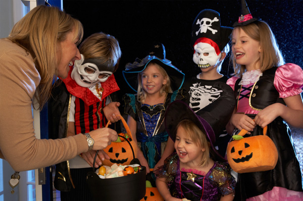 Woman giving kids candy