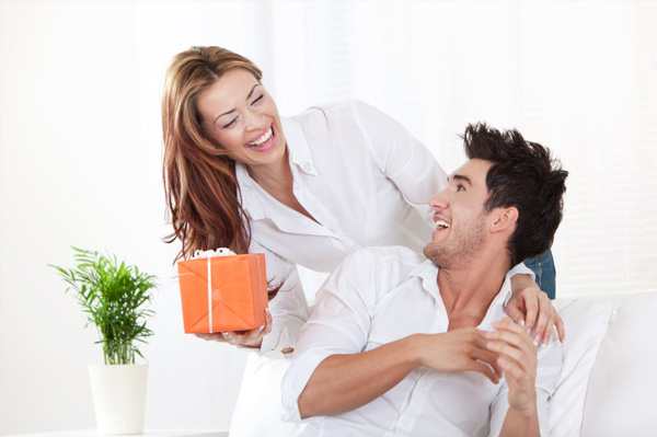 Woman giving gift to boyfriend