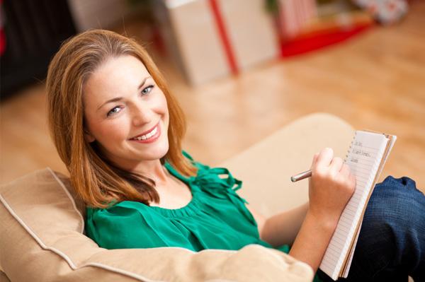 Woman writing in gratitude journal