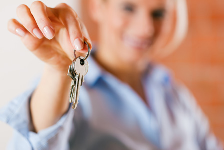 Woman handing over keys to home