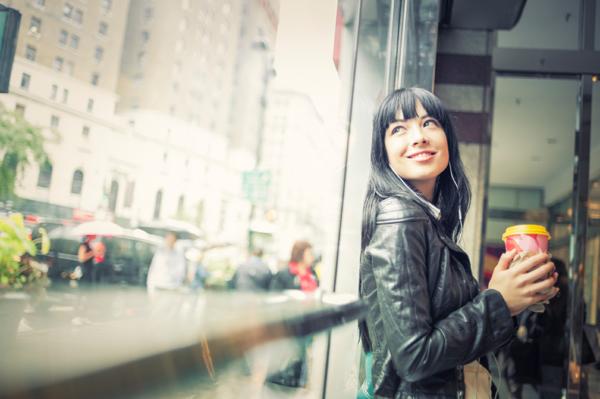 Woman having coffee in New York City